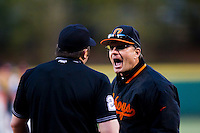 Head Coach Frank Anderson (3) of the Oklahoma State Cowboys argues with Home plate umpire John Brammer (24) during a game against the Missouri State Bears at Hammons Field on March 6, 2012 in Springfield, Missouri. (David Welker / Four Seam Images)