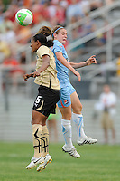 Candace Chapman (5) of FC Gold Pride and Heather O'Reilly (9) of Sky Blue FC go up for a header. FC Gold Pride defeated Sky Blue FC 1-0 during a Women's Professional Soccer (WPS) match at Yurcak Field in Piscataway, NJ, on May 1, 2010.