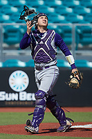 Western Carolina Catamounts catcher Kitt Capell (12) tracks a fly ball during the game against the Kennesaw State Owls at Springs Brooks Stadium on February 22, 2020 in Conway, South Carolina. The Owls defeated the Catamounts 12-0.  (Brian Westerholt/Four Seam Images)
