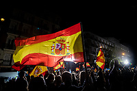 MADRID, SPAIN – MAY 04: A group of people waves the Spanish flag in front of the PP headquarters as a sign of victory on 4 May in Madrid, Spain. (Photo by Joan Amengual / VIEWpress via Getty Images)