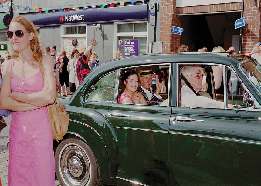 """2014 Queen of Wymondham, Wednesday Bachelor is escorted by Mayor Colin Foulger. They are chauffeured by Mr Mike Collins in his Bentley S3.<br /> <br /> """"Paleontologist and natural historian Wednesday Bachelor, who lives on Elise Way, was chosen to don the prestigious carnival queen tiara."""""""