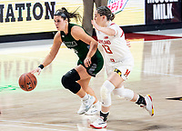 COLLEGE PARK, MD - DECEMBER 8: Stephanie Karcz #10 of Loyola dribbles past Faith Masonius #13 of Maryland during a game between Loyola University and University of Maryland at Xfinity Center on December 8, 2019 in College Park, Maryland.