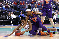 GREENSBORO, NC - MARCH 6: Shania Meertens #31 of Clemson University and Taylor Soule #13 of Boston College dive after a loose ball during a game between Clemson and Boston College at Greensboro Coliseum on March 6, 2020 in Greensboro, North Carolina.