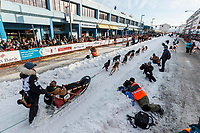 Anna Berington leaves the start line on 4th avenue during the ceremonial start of the 2019 Iditarod in downtown Anchorage, Alaska on Saturday March 2.<br /> <br /> Photo by Jeff Schultz/  (C) 2019  ALL RIGHTS RESERVED