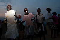Africa, Sudan, Magwi County, Nimule, Southern Sudan - Children sing and dance at an orphanage in Nimule. The area is in the heart of Lord Resistance Amy territory. December 2005 © Stephen Blake Farrington