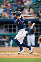Northwest Arkansas Naturals third baseman Jack Lopez (1) follows through on a swing during a game against the Midland RockHounds on May 27, 2017 at Arvest Ballpark in Springdale, Arkansas.  NW Arkansas defeated Midland 3-2.  (Mike Janes/Four Seam Images)
