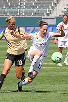 Liz Bogus #17 of the Los Angeles Sol battles for control of the ball against Leslie Osborne #10 of FC Gold Pride during their match at Home Depot Center on April 19, 2009 in Carson, California.