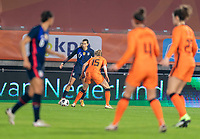 BREDA, NETHERLANDS - NOVEMBER 27: Tobin Heath #17 of the USWNT is defended by Lynn Wilms #15 of the Netherlands during a game between Netherlands and USWNT at Rat Verlegh Stadion on November 27, 2020 in Breda, Netherlands.