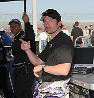 """HOMESTEAD, FL - MARCH 29, 2008:  Grey's Anatomy Actor Patrick """"McDreamy"""" Dempsey looking like he got to much sun,  watches his team mates in the Gainsco Grand Prix of Miami follwing his driving shift at the Homestead Miami Speedway on March 29, 2008 in Homestead, Florida.<br /> <br /> People:  Patrick Dempsey"""