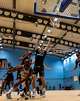 Rahmon Fletcher of Newcastle Eagles drives under the basket and scores during the BBL Championship match between Surrey Scorchers and Newcastle Eagles at Surrey Sports Park, Guildford, England on 20 March 2021. Photo by Liam McAvoy.