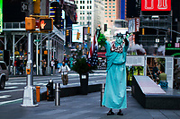NEW YORK, NY - OCTOBER 20: A man disguised as Statue of Liberty wait for tourists at Times Square on October 20, 2020 in New York, with more than a 72% decline in tourism activity since the spread of the pandemic. Hotels, restaurants, museums, are more affected across New York State.  (Photo by Eduardo MunozAlvarez/VIEWpress)