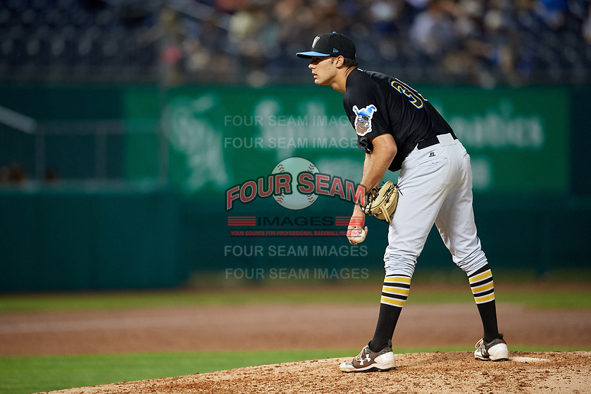 West Virginia Black Bears relief pitcher Allen Montgomery (39) looks in for the sign during a game against the State College Spikes on August 30, 2018 at Medlar Field at Lubrano Park in State College, Pennsylvania.  West Virginia defeated State College 5-3.  (Mike Janes/Four Seam Images)