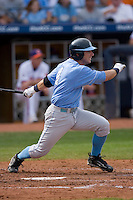 Garrett Gore #4 of the North Carolina Tar Heels follows through on his swing versus the Clemson Tigers at Durham Bulls Athletic Park May 23, 2009 in Durham, North Carolina. The Tigers defeated the Tar Heals 4-3 in 11 innings.  (Photo by Brian Westerholt / Four Seam Images)