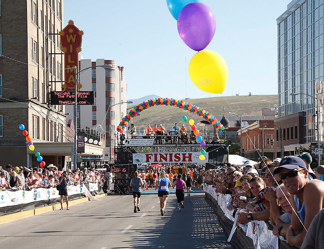 Runners approaching the finish line of the missoula marathon on the higgins avenue bridge in missoula, montana