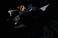 Pictured: A refugee man rests inside the Helliniko camp Friday 26 February 2016<br /> Re: Refugees have been turning up at the Helliniko refugee camp in the outskirts of Athens, Greece.