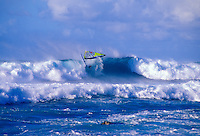 A windsurfer gets caught up in a large wave at Hookipa Beach Park on Maui's North Shore. This is Maui's most popular surf and windsurfing beach just off the Hana Highway and near Mama's Fishhouse, outside the town of Paia.