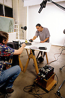 College students in photography class working in studio to shoot picture