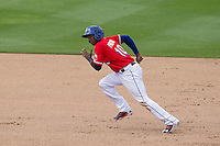 Round Rock Express second baseman Jurickson Profar #10 runs to third base against the Omaha Storm Chasers in the Pacific Coast League baseball game on April 7, 2013 at the Dell Diamond in Round Rock, Texas. Omaha beat Round Rock 5-2, handing the Express their first loss of the season. (Andrew Woolley/Four Seam Images).