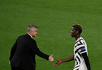 Football: Uefa Europa League - semifinal 2nd leg AS Roma vs Manchester United Olympic Stadium. Rome, Italy, May 6, 2021.<br /> Manchester United's coach Ole Gunnar Solskjaer (L) greets Manchester United's Paul Pogba (R) when he leaves the pitch during the Europa League football match between Roma and Manchester United at Rome's Olympic stadium, Rome, on May 6, 2021.  <br /> UPDATE IMAGES PRESS/Isabella Bonotto