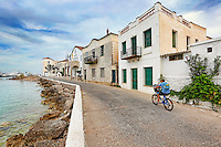 A bicyclist in the town of Spetses island, Greece
