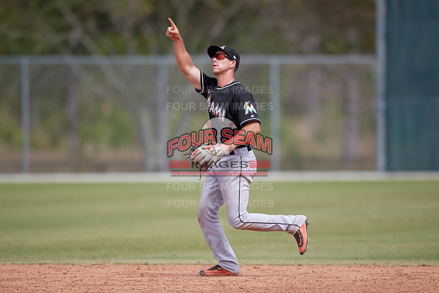 Miami Marlins Matt Brooks (33) points to a pop up during a minor league Spring Training game against the New York Mets on March 26, 2017 at the Roger Dean Stadium Complex in Jupiter, Florida.  (Mike Janes/Four Seam Images)
