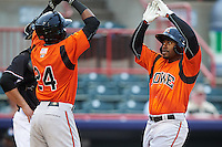 Bowie Baysox designated hitter Quincy Latimore (22) is congratulated by Julio Borbon (24) after hitting a home run during a game against the Erie SeaWolves on May 12, 2016 at Jerry Uht Park in Erie, Pennsylvania.  Bowie defeated Erie 6-5.  (Mike Janes/Four Seam Images)