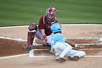 Justice Thompson (20) of the North Carolina Tar Heels is tagged out by South Carolina Gamecocks catcher Wes Clarke (28) as he tries to score a run at Truist Field on April 6, 2021 in Charlotte, North Carolina. (Brian Westerholt/Four Seam Images)