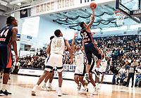 WASHINGTON, DC - NOVEMBER 16: David Syfax Jr. #32 of Morgan State shoots over Jameer Nelson Jr. #12 of George Washington during a game between Morgan State University and George Washington University at The Smith Center on November 16, 2019 in Washington, DC.