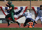 Black Hills State runningback Tanner Ehrlich #5, dances into the endzone Saturday, just ahead of a diving Dustin Meneley, #23, to score the Yellow Jackets' first touchdown of the day against South Dakota School of Mines & Technology. (Photo by Steve McEnroe/Inertia)