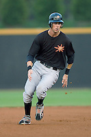 Billy Rowell #11 of the Frederick Keys rounds second base at Wake Forest Baseball Stadium August 6, 2009 in Winston-Salem, North Carolina. (Photo by Brian Westerholt / Four Seam Images)