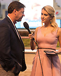HALLANDALE BEACH, FL - FEBRUARY 04: Graham Motion, trainer of Irish War Cry being interviewed by Acacia Courtney after winning the Holy Bull Stakes (G2) at Gulfstream Park. (Photo by Arron Haggart/Eclipse Sportswire/Getty Images)