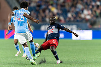 FOXBOROUGH, MA - SEPTEMBER 11: Emmanuel Boateng #11 of New England Revolution fails to dribble past Talles Magno #43 of New York City FC during a game between New York City FC and New England Revolution at Gillette Stadium on September 11, 2021 in Foxborough, Massachusetts.