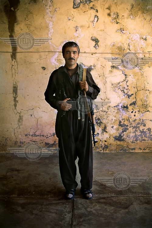 A Kurdish peshmerga fighter from the Democratic Party of Iranian Kurdistan (PDKI) at one of the party's base camps.