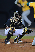 Central Florida Knights catcher Kyle Perkins (24) during the season opening game against the Siena Saints at Jay Bergman Field on February 14, 2014 in Orlando, Florida.  UCF defeated Siena 8-1.  (Copyright Mike Janes Photography)