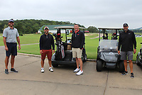 Corey Bartlett (from left), Drew Sadler, Matt Shy and Jason Fremstad prepare to take the course at Golf with the Finest. <br />
