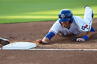 Round Rock Express second baseman Greg Miclat #1 dives back to first base during a pick off attempt in the first inning of the Pacific Coast League baseball game against the Omaha Storm Chasers on July 22, 2012 at the Dell Diamond in Round Rock, Texas. The Express defeated the Chasers 8-7 in 11 innings. (Andrew Woolley/Four Seam Images)...