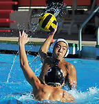 Arcadia High School water polo player rises up to take a shot against Pasadena High School player.