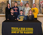 November 15, 2017- Tuscola, IL-  Tuscola's Michael Holmes signed his letter of intent to compete in Cross Country for the Danville Area Community College Jaguars. Those present standing from left are Warrior coach Shannon Smith, brother Marcus Holmes, DACC coach Jim Acklin, brother Mason Holmes, and Warrior coach Dustin Dees. Seated from left are father Mike Holmes, Michael Holmes, and mother Jean Holmes. [Photo: Douglas Cottle]