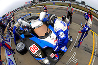 The #08 Peugeot Sport 908 HDI/FAP of Franck Montagny & Stephane Sarrazin makes a pit stop.