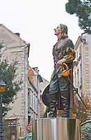 The new statue of Cyrano de Bergerac on the main town square in Bergerac, unusual in that it is painted in colour and standing on a stainless steel pedestal. on Place Pelissiere Square Bergerac Dordogne France