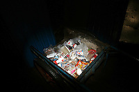 CHINA. Beijing. Trash lying in an abandoned cart in the shopping district of Xidan . 2008