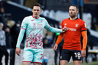 (L-R) Connor Roberts of Swansea City and Jordan Clark of Luton Town in action during the Sky Bet Championship match between Luton Town and Swansea City at Kenilworth Road, Luton, England, UK. Saturday 13 March 2021