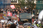 Scott Sinclair holds the trophy with Swansea City Football Club players and staff celebrating their promotion to the Premier League with an opentop bus tour of the city, where thousands of supporters turned out to show their appreciation..