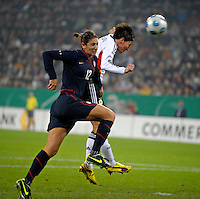 Linda Bresonik (right) heads the ball over Yael Averbuch. US Women's National Team vs Germany at Impuls Arena in Augsburg, Germany on October 27, 2009.