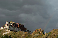 A big rainstorm approching the Potala in the late afternoon with arainbow appearing..Little remains of the original Potala Palace of the seventh century, built as a place for meditation by King Songtsen Gampo on the occasion of his marriage to Princess Wencheng of the Tang Court. Standing atop the Red Hill in Lhasa, the current structure dates from the 17th century; it was rebuilt by the 5th Dalai Lama and became the Winter Palace of the Dalai Lamas from that time. The 13-story building of 1,000 rooms can be seen from many miles away...The Potala is divided into two sections--an outer section, the White Palace, and an inner section, the Red Palace, the latter containing the temples and reliquary tombs of the Dalai Lamas. The entire building is a structure of stone and timber. At a height of 117 meters, the Potala was the world's tallest building until 20th-century architects designed cityscapes of new buildings that far surpassed the Potala in height--but not in its architectural majesty..