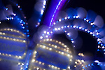 """A photography technique called """"focus blur"""" is used to transform the lights of a carnival ride into abstract designs at the Montgomery County Agricultural Fair in Gaithersburg, Maryland."""
