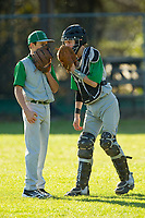 Justin Jarvis of the Kannapolis Eagles has a chat on the mound with his pitcher during the game against the Northwest Cabarrus Titans in middle school baseball action at Northwest Cabarrus High School on March 21, 2013 in Kannapolis, North Carolina.  The Titans defeated the Eagles 21-14.  (Brian Westerholt/Four Seam Images)