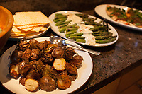 """SEATTLE, WA-APRIL 17, 2017: Rosemary potatoes, Matzah, Asparagus with yogurt and orange sauce and Salmon Horseradish with caramelized onions were among the dishes served during the dinner party. <br /> <br /> Amanda Saab, along with her husband Hussein Saab, host a """"dinner with your Muslim neighbor"""" at the home of Stefanie and Nason (cq) Fox in Seattle, WA on a return trip April 17th 2017. The couple now live in Detroit.<br /> (Photo by Meryl Schenker/For The Washington Post)"""