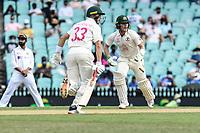 7th January 2021; Sydney Cricket Ground, Sydney, New South Wales, Australia; International Test Cricket, Third Test Day One, Australia versus India; Marnus Labuschagne of Australia and Will Pucovski of Australia cross mid wicket for runs