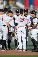 Kannapolis Intimidators pitching coach Matt Zaleski (25) has a meeting on the mound with starting pitcher Bernardo Flores (17) and the entire infield during the game against the Lakewood BlueClaws at Kannapolis Intimidators Stadium on April 9, 2017 in Kannapolis, North Carolina.  The BlueClaws defeated the Intimidators 7-1.  (Brian Westerholt/Four Seam Images)